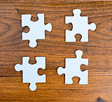 Four blue pieces of puzzle