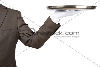 Arm in white glove with empty flat plate