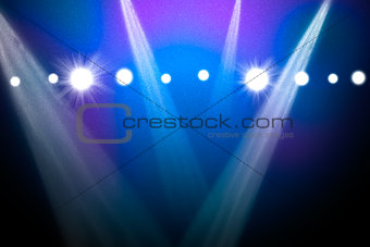 Abstract blue background with spotlights
