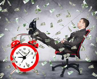 Time is money concept with businessman