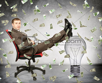 Businessman with light bulb and money rain