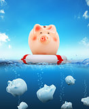 Piggy bank with buoy floating on water