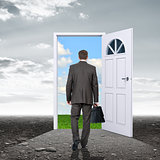 Businessman with door in colorful nature