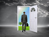 Businessman in grey room with door in nature