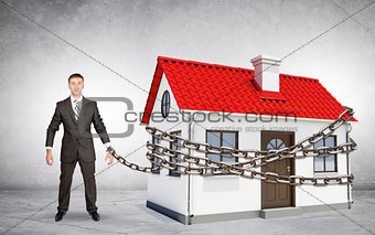 Businessman chained to house