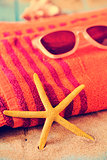 starfish, sunglasses and beach towel