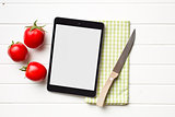 computer tablet and tomatoes