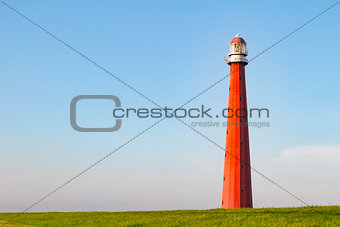 Beautiful Red Lighthouse under a blue sky