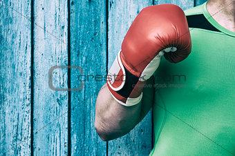torso of a man and a right-hand man in red boxing gloves