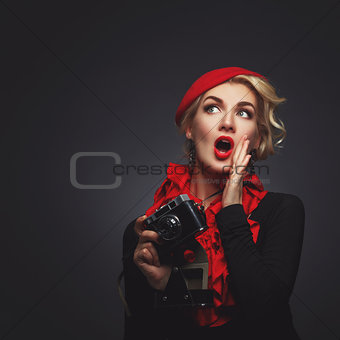 Beautiful lady with retro photo camera