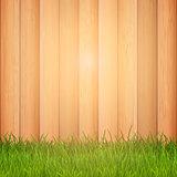 Grass on wooden background