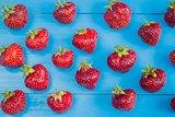 Fresh strawberries on blue background