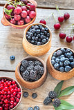 Bowls of berries on the wooden table