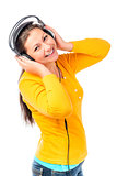 cheerful girl with a beautiful smile in headphones