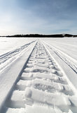 Snow Mobile Tracks on Lake