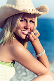 Beautiful Blonde Woman Girl in Hat on Beach