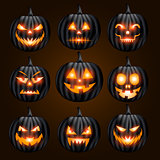 Jack o lantern pumpkin faces glowing on black background