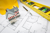 Home, Level, Hard Hat and Pencil Resting on House Plans