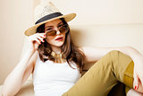 pretty young woman wearing sunglasses and summer hat, fashion people concept hipster