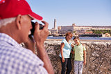 Grandparents With Boy Family Holidays In Cuba Taking Photo