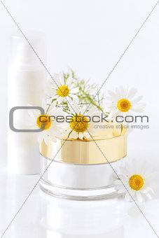 chamomile and jars of cream