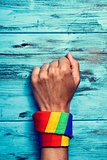 man with a rainbow-patterned kerchief in his wrist