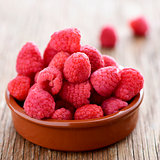 raspberries on a wooden table