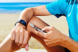 young sportsman syncing his smartwatch