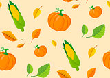 Seamless pattern from autumn leaves and pumpkins.