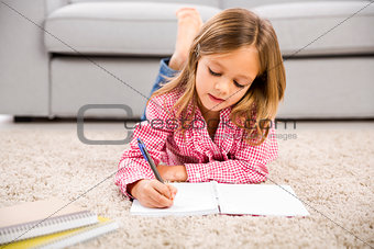 Little girl making homework