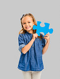 Girl holding a puzzle