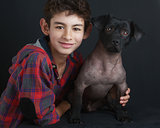 Portrait of Boy and Peruvian Dog