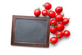 red tomatoes and blank chalkboard