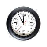 Big round wall clock isolated on yellow close-up