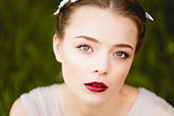 Close-up portrait of young girl with green eyes a quality makeup. Boho style