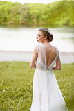 Beautiful girl in white long dress with open back