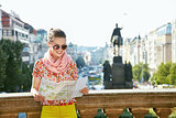 Smiling woman looking at map near National Museum in Prague