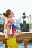 Woman with Czech flag standing at Wenceslas Square in Prague