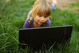 beautiful little girl with a laptop