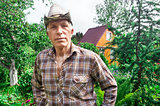 Farmer on the background of a summer garden