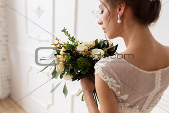 Portrait of the bride in a wedding dress with a bouquet