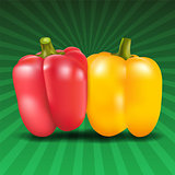 Yellow and red sweet pepper on green background.