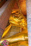 Reclining big Buddha gold statue in Wat Pho, Bangkok, Thailand