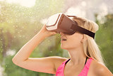 young woman feeling excited for using virtual reality headset