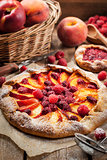Rustic open pie with peach and raspberry