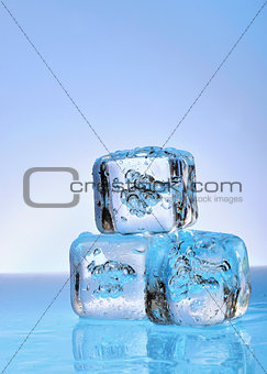 Three ice cubes on glass
