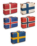 Vintage suitcases with Scandinavian flags