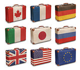 Vintage suitcases with G8 and EU flags