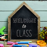 text welcome to class in a house-shaped chalkboard