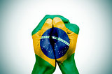 hands patterned with the flag of Brazil